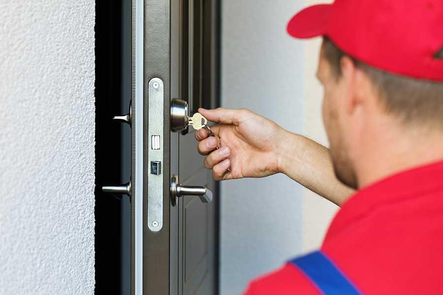 commercial locksmith. Delighful Locksmith A Commercial Locksmith In Newark Installs A Lock Intended Commercial Locksmith M